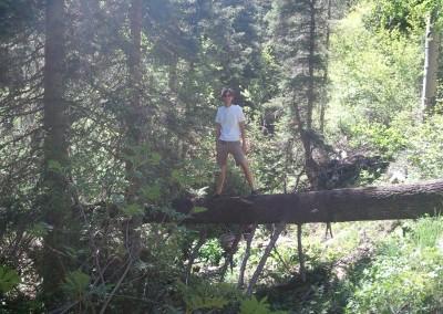 posing on a fallen tree